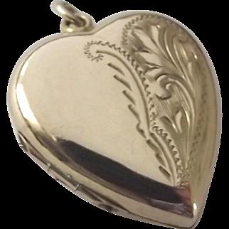 Vintage 9ct gold puffy love heart locket