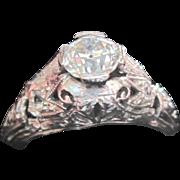 Platinum and seven diamond filagree engagement ring