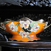 Elongated Phoenix Ware English bowl decorated with lush orchids