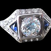 Platinum & diamond engagement ring with sapphires