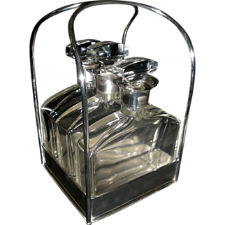REDUCED Hallmarked English Silver Tantalus with Sterling collared hand formed decanters