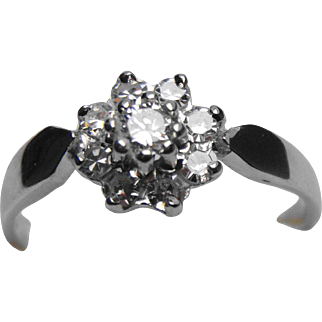 18 Carat white gold and diamond vintage daisy ring