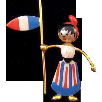 Miniature 'Puffed' Woman Holding a Flag Pin