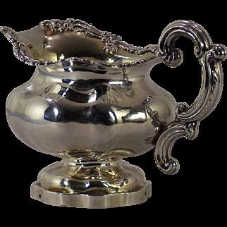 A fine early 19th century Russian Imperial cast silver gilt creamer, maker's mark for Adolf Sper, assay master's mark for Dimitri Ilych Tverskoi, St. Petersburg, 1844.