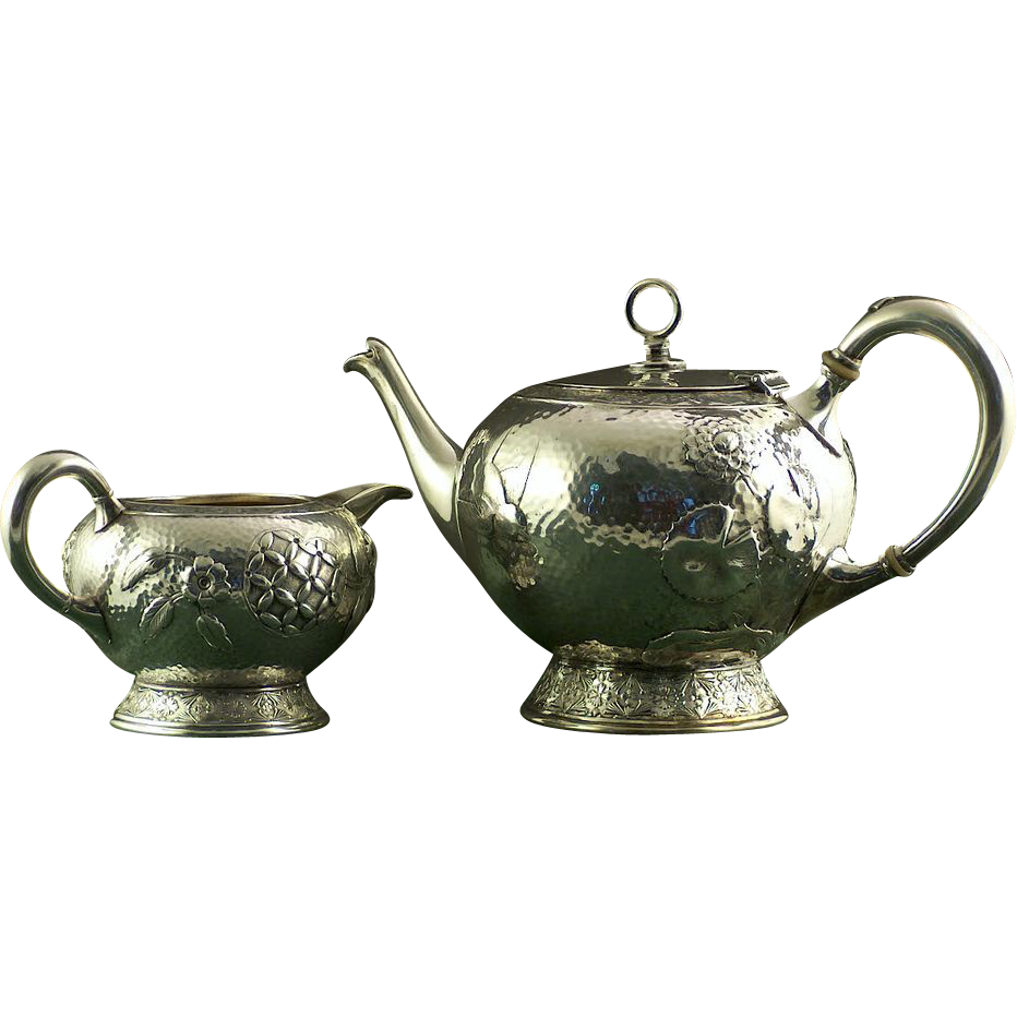 A Rogers & Bro., and Rogers Smith & Co.  Aesthetic hammered silver plated tea pot and creamer. Meriden, Ct. circa 1883.