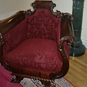 Turn of the century American Empire style throne chair claw feet dolphin handles