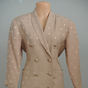 A Dress Suit Of Taupe With Contrasting Taupe Dots