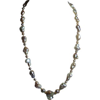 Multi coloured big baroque cultured pearl necklace with 18kt & a 14K gold clasp.