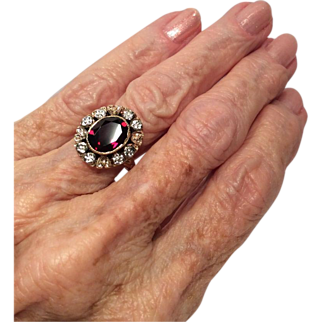 14 K Rose and White Gold Ring Set with a Garnet