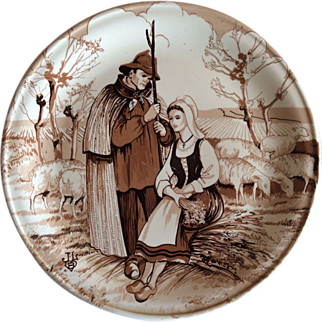 French decorative plate with a farming couple and sheep