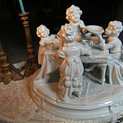 """Beautiful porcelain statue """"Children on the dinner table""""."""