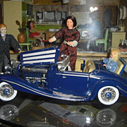 """Beautiful vintag Mercedes with """"family"""" of 3 Cacao dolls."""