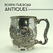 Repoussé Baby's Cup with Blown-out Head and Floral Design - 1890's