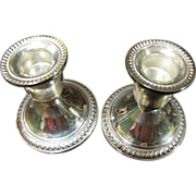 Elegant Pair of Mid Century Duchin Sterling Silver Weighted Candle Holders