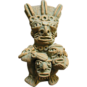 Primitive Clay Figurine of the Peruvian Moche God Ai-Apec with Decapitated Heads (No 1)