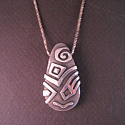 Sterling Silver Carved double sided Zealandia style Pendant and chain.
