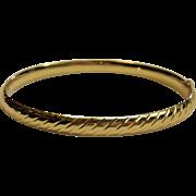 Striking Slightly Oval-Hinged Bangle Bracelet in 14K Yellow Gold