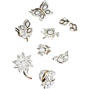 """1967 """"LITTLE WHITE TRIFARI FIGURAL COLLECTION"""" White Enamel/White Cabochon Figural Brooch/Pin Collection  BOOK PIECE/AD with Bonus Earrings"""