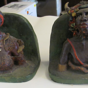 "Unusual South african ""Devil Doctor"" and girl bookends signed C.H Griggs"