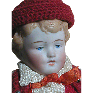 German All Bisque Doll  Jointed  Molded Hair  Two front Teeth Original Knit Outfit