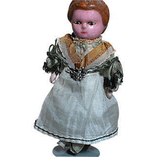 Antique Wax Over Doll  Doll House Size  Black glass Eyes Squeaker in Mid-Section Works Great Outfit   1800s