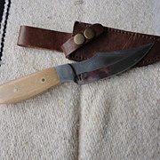 Custom made white handle hunting knife