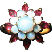 Opal and Garnet Ring in 10 K yellow Gold