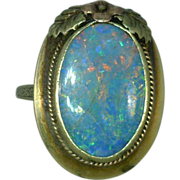Oval Opal 14 Karat Gold Ring with Flower Accents