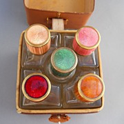 Five Scent bottles with Guilloche Enamel tops in Leather case, c. 20-30's