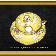 Paragon Fine Bone China (England) Cup & Saucer in a yellow glaze made for William Junor (Toronto, Canada)