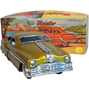 Vintage Minister Friction Drive Toy Tin Car in Gold Paint 1950's