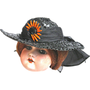 Black Straw Doll Hat with Orange and Black Daisy Ornament
