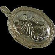 Oval Engraved & embossed Silver Locket