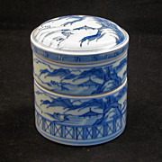 Two-tier blue and white Chinese porcelain segmented food container with landscapes ca.1900