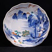 Late Edo (1820-1860) Japanese porcelain Imari bowl of waterfall and mountain scene