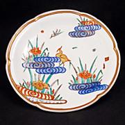 Japanese porcelain Meiji era (1868-1912) deep plate with crane amongst Iris in stylized rippled pond