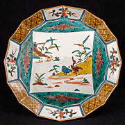 Japanese porcelain Meiji era (1868-1912) faceted ao-kutani plate with central scene of waterfowl with flora and kimono pattern border