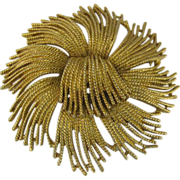 Large MONET gold-tone firework burst pin