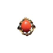 Red Coral Cabochon set in fourteen karat yellow gold