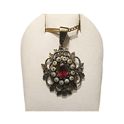 Garnet and pearl pendant set in silver, 19th century
