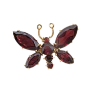 Fourteen karat yellow gold and Garnet brooch in the shape of a butterfly,about 1970