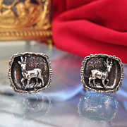 Pair of silver cuff links with beautiful relief work, ca. 1920