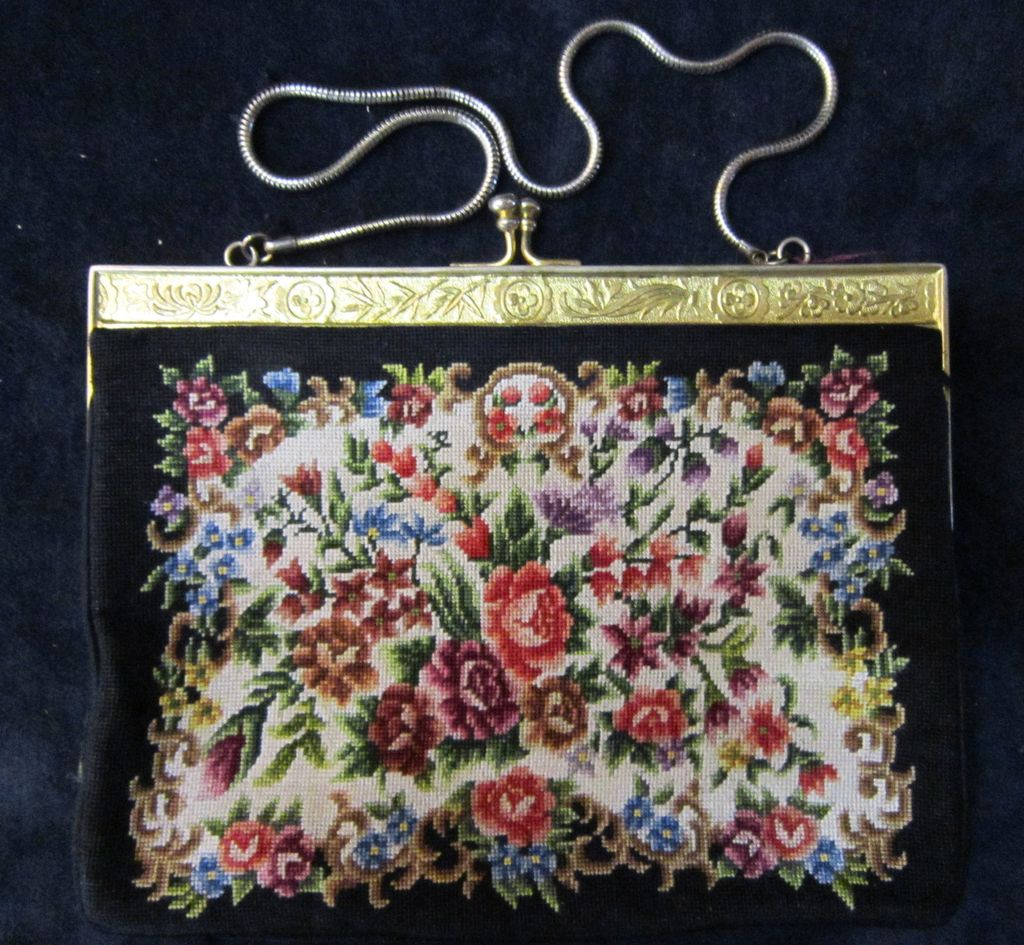 A Vintage Petite Point Embroidered Evening Hand Bag With A Gilded Brass Frame