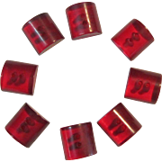 A Set of 8 Vintage Mid-Century Red Lucite Buttons