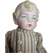 Adorable All Bisque Doll in Striped Outfit
