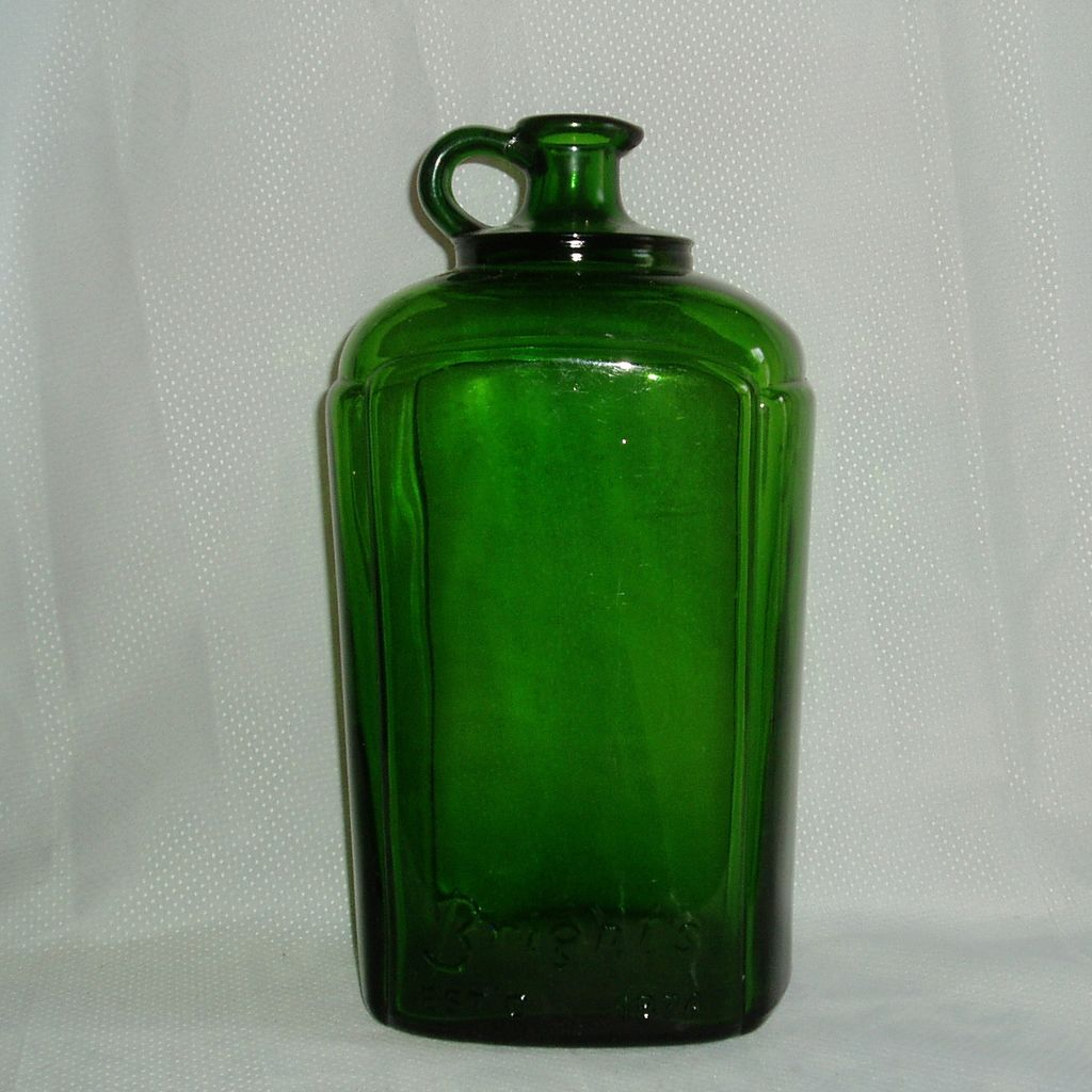 Old green Brights pour spout wine bottle