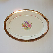 9.5 by 7 inch wide Platter 22kt gold rim floral center Stetson China USA