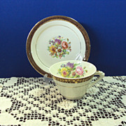 TeaCup and Saucer Stetson China 22 kt Gold Rim with Floral Center