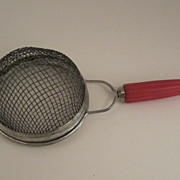 Androck Red Bakelite Strainer with Bullet Handle Vintage Kitchen Utensil