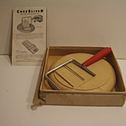 Red Bakelite Cheese Slicer with Cheese Board in Original Box